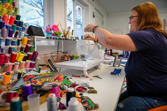 Making use of fabric and elastic cord on hand, Henderson resident Tiffany Willett is making face masks in her home shop she normally uses to make dog collars.