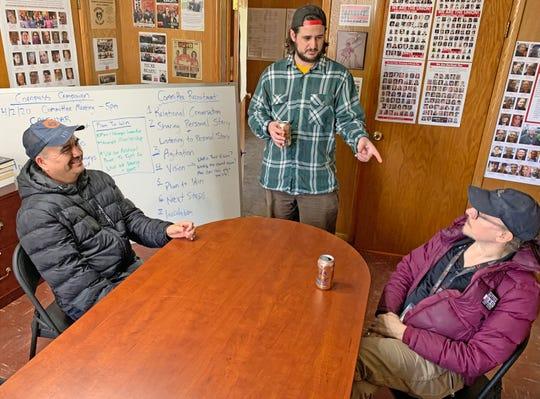 Ignacio Martinez, 59; Stuart Mora, 34; and Mark Tannenbaum, 62, talk in the union offices of Unite Here and SEIU Local 1. Martinez is a custodial worker at an Elanco facility.