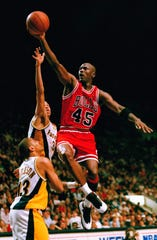 Chicago Bulls guard Michael Jordan (45) flies to the hoop over the Indiana Pacers Reggie Miller and Mark Jackson (13) during the third quarter, March 19, 1995 in Indianapolis. Despite Jordan?s return to basketball, the Pacers beat the Bulls 103-96 in overtime.