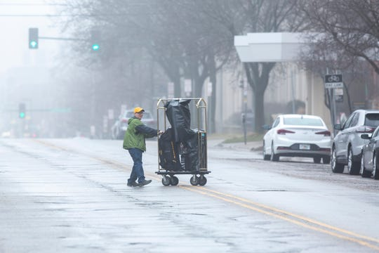 University of Iowa students move out of residence hall dorms, Thursday, March 19, 2020, along Clinton Street in Iowa City, Iowa.