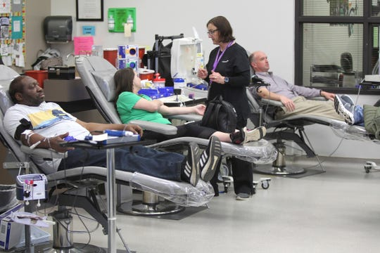 Area residents give blood at Vitalant in Tupelo, Miss., on Tuesday, March 17, 2020.