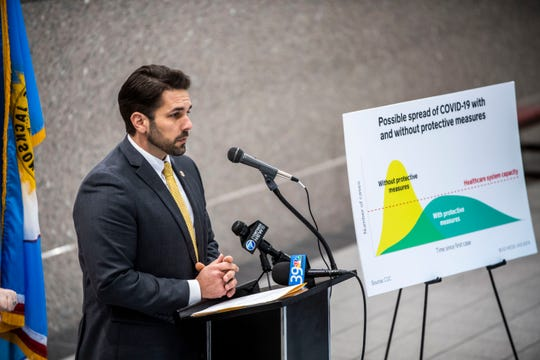 Mayor Scott Conger holds a press conference at City Hall, Thursday, March 19, 2020 in Jackson, Tenn. to announce he is ordering all restaurant businesses to close the bars and night clubs and limit a 50% capacity for the publics health.