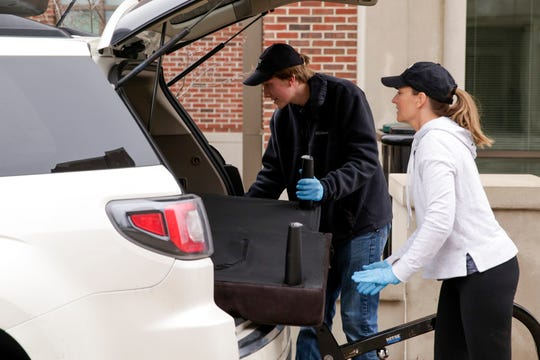 Ryan Rask, a freshman first year engineering student and his mom, Margaret Rask, load his futon into their car as he moves out of his Honors College dorm at Purdue University, Thursday, March 19, 2020 in West Lafayette