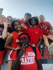 Aarushi Kanukunta (left, middle) with her friends at duPont Manual's football game against Male High School in fall 2019. The senior is worried that COVID-19 will impact her final high school moments.