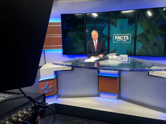 WHAS11's Doug Proffitt sat alone at the anchor desk as the Louisville television station has reduced staff working in the building during the coronavirus situation.