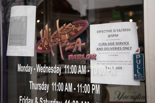 Wick's Pizza Parlor on Baxter Avenue is a popular sports bar that is now closed for dine-in, but still open for curb-side service and deliveries. March 19, 2020