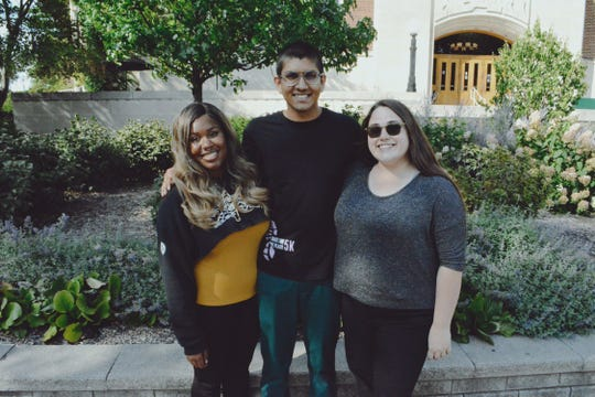 Zaria Phillips, left, poses with two fellow Holden intercultural aides in 2018 out front of the MSU Union.
