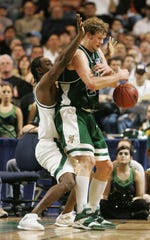 Taylor Coppenrath of Vermont loses control of the ball while being guarded by Matt Trannon of Michigan State during the second round of the NCAA Men's Basketball Championship at the DCU Center March 20, 2005, in Worcester, Massachusetts.