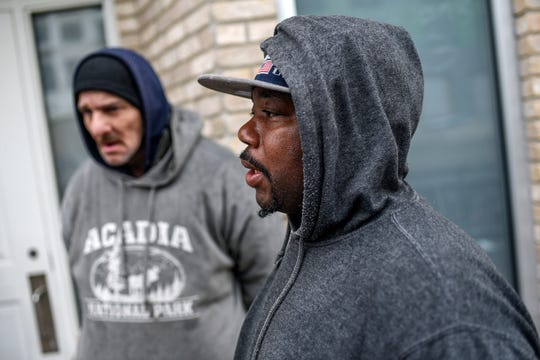 Larry Wilder waits outside the City Rescue Mission of Lansing on Wednesday, March 18, 2020. Wilder just got off work and arrived at the mission to get a meal.