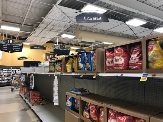 A Kroger store has placed chips where toilet paper would normally be stocked.