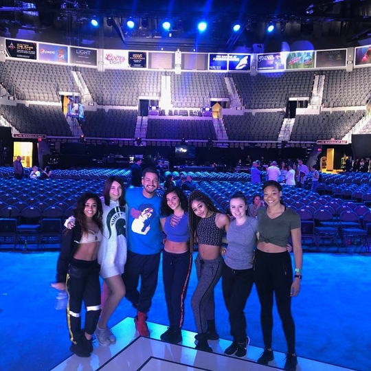 Glenn Douglas Packard (center) with several dancers from the INstitute of Dancers in Las Vegas for the Billboard Latin Music Awards in April 2019.