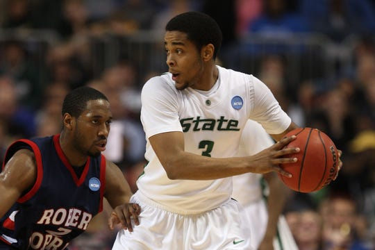 Michigan State's Chris Allen looks to pass the ball against Robert Morris' Mezie Nwigwe during the first round of the NCAA Division I Men's Basketball Tournament at the Hubert H. Humphrey Metrodome on March 20, 2009, in Minneapolis, Minnesota.