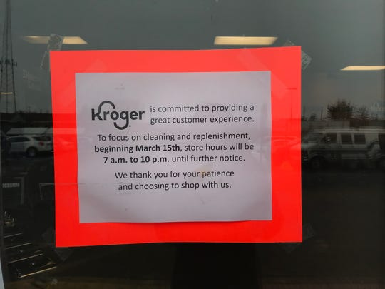 A sign at a Kroger store at West Holmes Road in Lansing on Thursday, March 19, 2020.