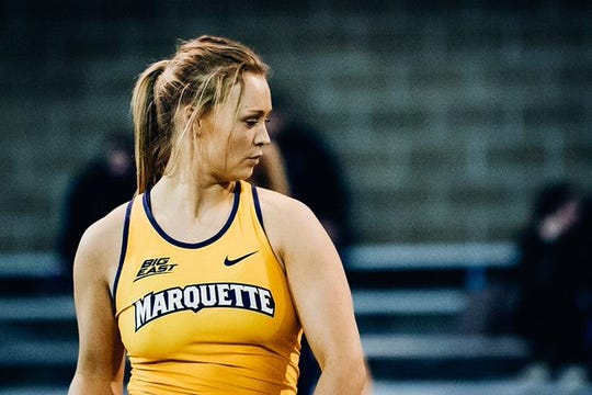 Marquette pole vaulter Kelly Jacoby, a Roncalli alum, found out her world was upside down while flying to visit her boyfriend in Washington when he texted that the NCAA had canceled the spring season.