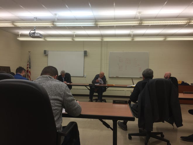 Lexington school board members and administrators observed social distancing at Wednesday's meeting.