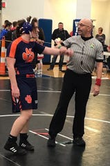 Galion senior Anna Court gets her arm raised in victory at the first-ever all-girls state wrestling tournament.