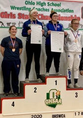 Galion senior Anna Court on the awards podium after finishing fourth in the first-ever all-girls state wrestling tournament.