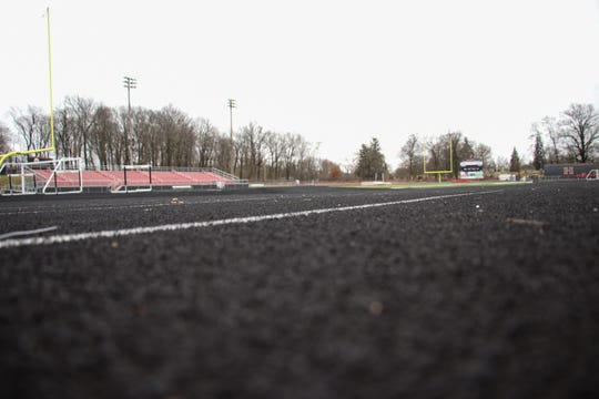 The track at Harding Stadium is dormant Thursday afternoon after the OHSAA declared a non-contact period of three weeks for member schools.