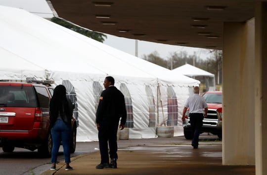Preliminary construction of a drive-thru coronavirus testing site is erected as first responders prepare a dry run outside the Liberty Bowl Memorial Stadium on Thursday, March 19, 2020.