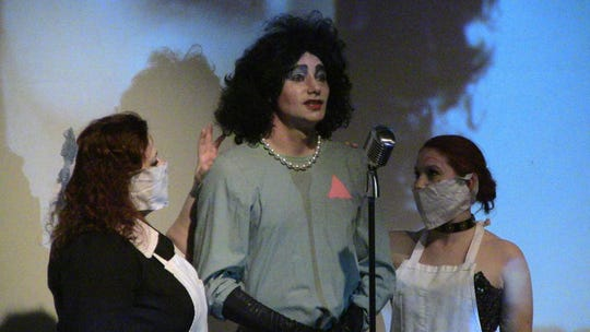 """Mystie Watson, Scott Sumers and Ashley Suaird are in the lab to see what's on the slab during a """"Rocky Horror"""" performance."""