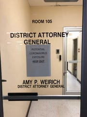 """Earlier Thursday, a sign was posted on an entrance to the Shelby County district attorney's office that read """"Potential coronavirus exposure, keep out."""" The sign, said Dist. Atty. Gen. Amy Weirich, was unauthorized, and created to cause fear and confusion."""