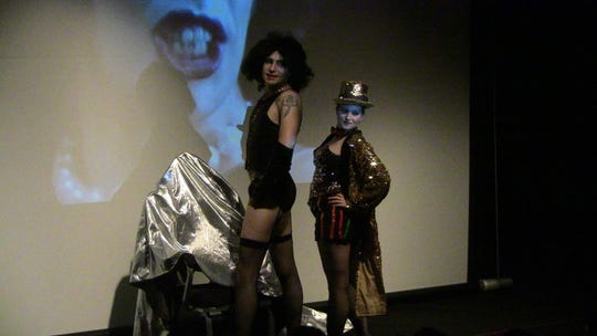 """Let's do the Time Warp again: Scott Sumers (Frank-N-Furter) and Ashley Suaird (Columbia) perform at a screening of """"The Rocky Horror Picture Show"""" at the Evergreen Theatre."""