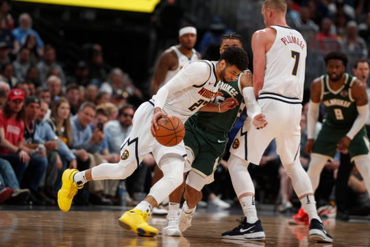 The Bucks' final game before the NBA shutdown was at Denver. On Thursday, the Nuggets announced someone within the organization, although not necessarily a player, has tested positive for coronavirus.