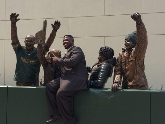 """LeRoy Butler is pictured with the """"Lambeau Leap"""" statue in his honor, unveiled in 2014 , just outside the team's pro shop and below the statues of Curly Lambeau and Vince Lombardi. President Mark Murphy said that a decision was made to honor the fans and not include Butler. """"Originally we thought maybe we would have a player and the fans would come around him, but ultimately, we decided that we thought the fans would be portraying the player, or portraying"""