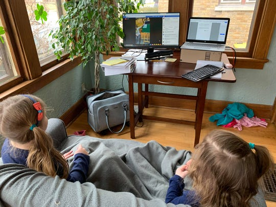 Two of Kristine Herman's daughters watch the live feed at home.