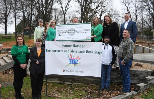 Farmers and Merchants Bank has donated $75,000 to the City of Mountain to build a permanent stage at Hickory Park for the city's two concert series that will start later this year. Shown above (front row, from left) Shonda Litty, Dayna Hall, Rickey Crawford, Mike McDonald, (second row, from left) Renae Schocke, Kristine Yunker, Amber Henry, Hillrey Adams, Shawna Rosson, Pepper Morrison and Brandon Scallion.