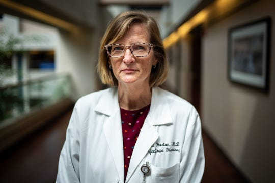 Dr. Juli Horton, an infectious disease specialist, poses for a portrait at TriStar Centennial Medical Center in Nashville, Tenn., Thursday, March 19, 2020.