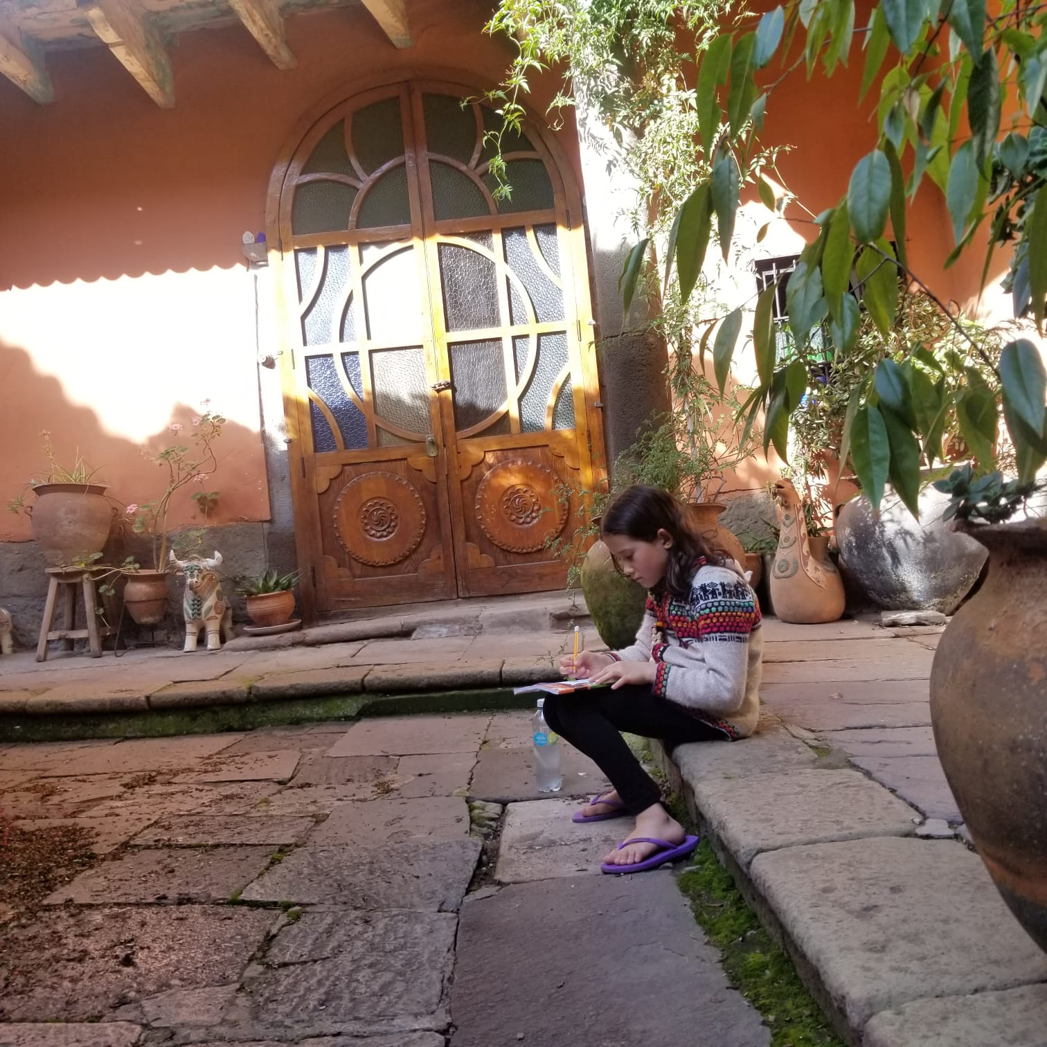 Anya Bailey, 8, has started journaling her experience during the lockdown in Peru, mom Stephanie said. She is pictured in the courtyard of the Airbnb where the family is staying.