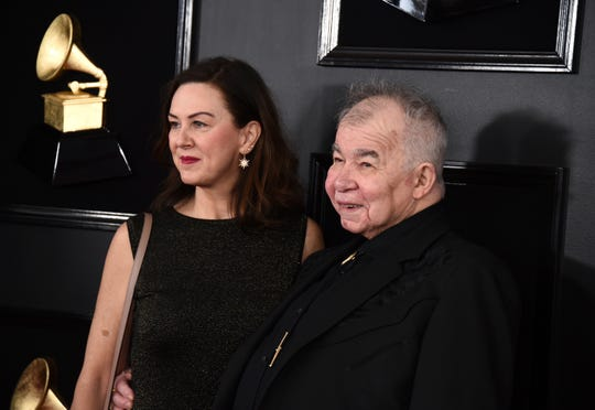 Fiona Whelan Prine, left, and John Prine arrive at the 61st annual Grammy Awards at the Staples Center on Sunday, Feb. 10, 2019, in Los Angeles. (Photo by Jordan Strauss/Invision/AP)