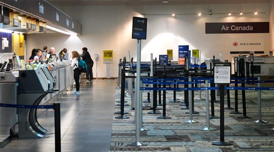 The check in counters are empty as travelers choose to stay at home. Traffic is down at BNA as travelers have cancelled or curtailed their travel plans in light of the coronavirus in Nashville, Tenn. Wednesday, March 18, 2020.