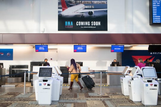 Less people arrive at Nashville International Airport due to the coronavirus and canceled flights Thursday morning, March 19, 2020, in Nashville, Tenn.