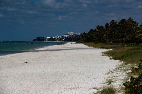 Naples Beach remained empty of visitors as pictured off the Naples Pier on Thursday, March 19, 2020.
