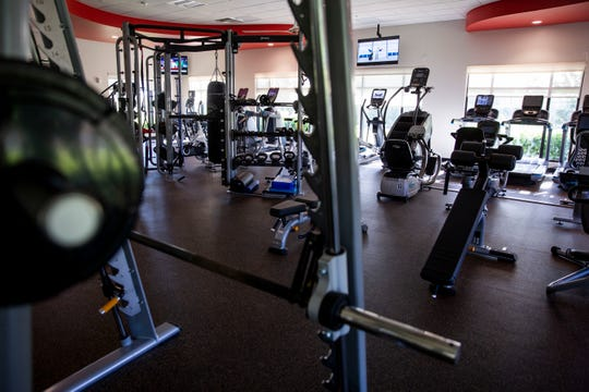Exercise machines sit unused in the wellness center at Countryside Golf & Country Club in Naples on Wednesday, March 19, 2020.