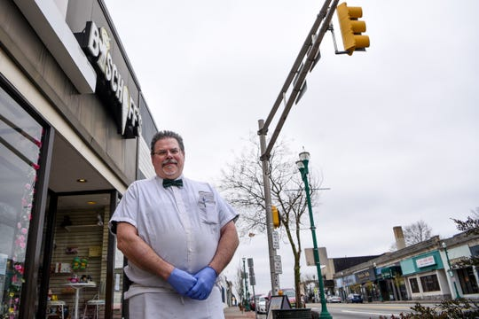 Steven Mather of Bischoff's ice cream shop in Teaneck, NJ poses for a photo on Thursday March 19, 2020. Bischoff's and other local stores are trying to adapt to new complications due to the Coronavirus.