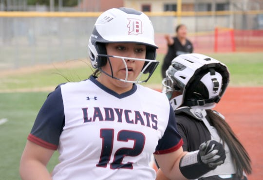Junior Lady 'Cat Aileen Jacquez (12) crosses home plate during Deming's double-header sweep over Santa Teresa High School back on March 10.
