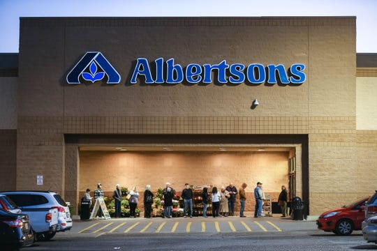 Dozens wait to shop at the Albertsons on Lohman Avenue in Las Cruces on Thursday, March 19, 2020. The grocery store is dedicating 7 to 9 a.m. Tuesdays and Thursdays to senior citizens and other at-risk populations.