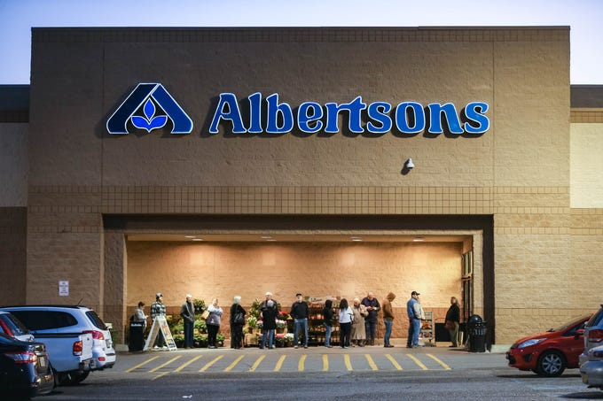 Dozens wait to shop at the Albertsons on Lohman Avenue in Las Cruces on Thursday, March 19, 2020. The grocery store will dedicate 7 to 9 a.m. Tuesdays and Thursdays to senior citizens and other at-risk populations.