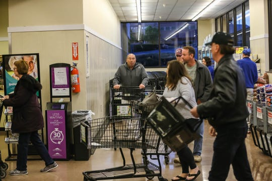 Dozens wait to shop at the Albertsons on Lohman Avenue in Las Crucess on Thursday, March 19, 2020. The grocery store will dedicate 7 to 9 a.m. Tuesdays and Thursdays to senior citizens and other at-risk populations.
