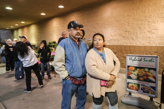 Guy and Irene Enriquez wait in line at 7 a.m. at Albertsons on Lohman in Las Cruces on Thursday, March 19, 2020.