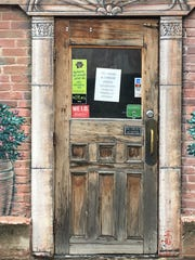 A sign on the Rubia's door urges customers to call ahead for curbside orders, Thursday, March 19, 2020, after an executive order prohibited dining in at restaurants due to coronavirus.