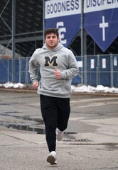 Catholic Central wrestler Brendin Yatooma jogs outside the school in Novi on March 19, 2020.