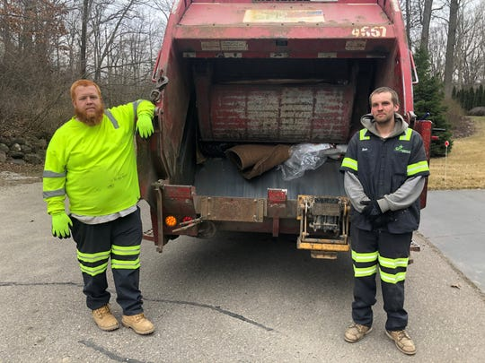 Austin Hayes and Zach Robinett, GFL sanitation workers, remain on the job March 18, 2020 in Milford during the troubled times of coronavirus.