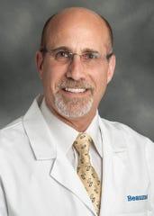Dr. Sanford Vieder.