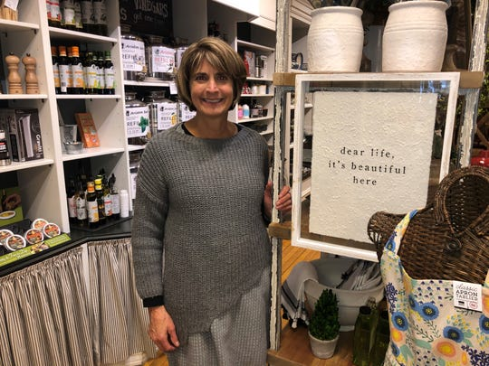 Kathy Magaluk, owner of Acorn Farm, a home goods store in Milford, with a positive message in spite of hard times caused by coronavirus.