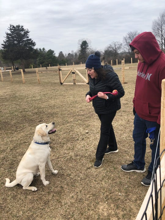 Dana and David Levenda, mother and son, with their dog, Remi at the Milford Dog Park on March 18, 2020.