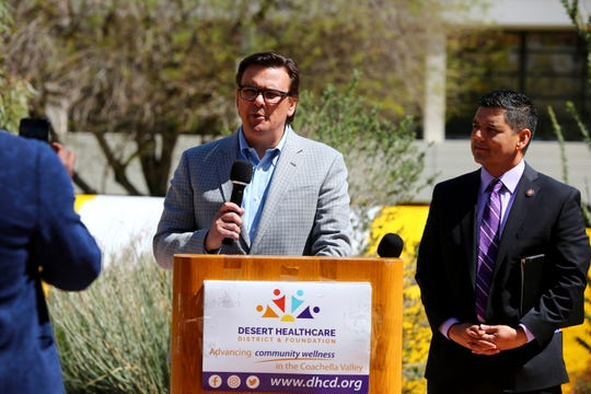 Rep. Raul Ruiz, right, listens to Dr. Conrado Barzaga during press conference at Desert Regional Medical Center in Palm Springs, Calif., on Thursday, March 19, 2020.
